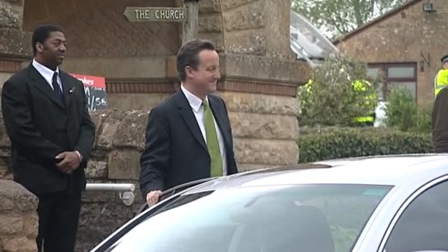 Conservative Party leader David Cameron with wife Samantha arrive at their local polling station to cast their votes on election day UK 6 May 2010