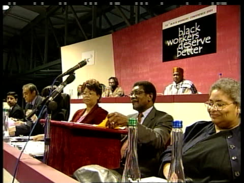 JOHN SCOTLAND Perth INT CMS MS Bill Morris sitting shuffling papers at Black Workers Conference MS Morris sitting with others GV Delegates applauding...