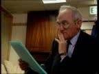 John Townend LIB MAT HELD MILLBANK London John Townend MP sitting reading document LIB MS Robin Cook MP towards into room