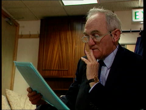 John Townend LIB MAT HELD MILLBANK London John Townend MP sitting reading document LIB MS Robin Cook MP towards into room