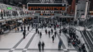 A constant flow of people move through the central concourse of Liverpool Street Railway Station
