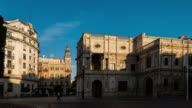 constitution avenue in sevilla spain sunshine timelapse with old buildings