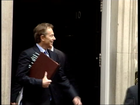 EU constitution referndum row ITN London Downing Street Tony Blair MP out of No10 with others and into car