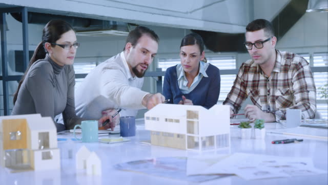 Construction and designer architectural team at a meeting
