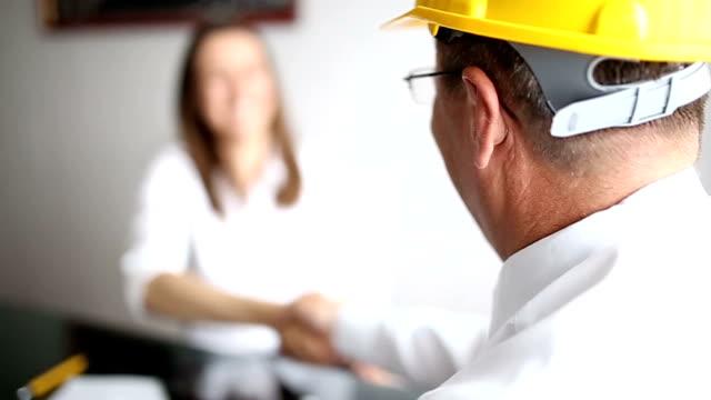 Construction engineer shaking hands