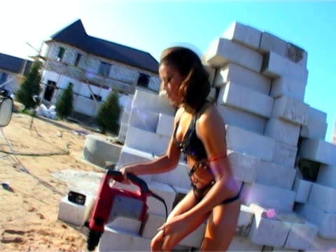 Construction Equipment in woman hand