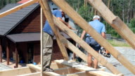Construction of the roof. Roofers work on the roof.