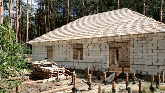 Construction site of a house in the forest.