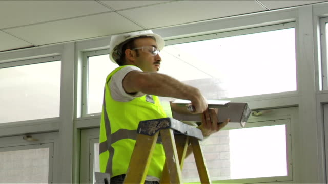 Construction Worker Applies Spackle to Ceiling on April 30 2012 in Washington DC