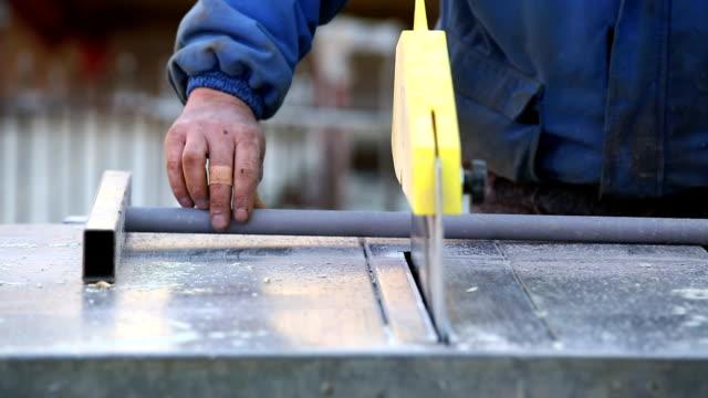 Construction Worker Cutting Plastic Pipe CU