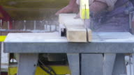Construction Worker Cutting Squared Lumber CU