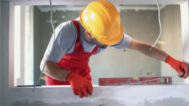 Construction worker finishing a wall.