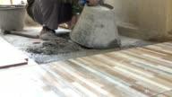 construction worker flooring, dolly shot 4k