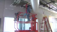 Construction Worker Installing Pipes at Lurie Children's Hospital on June 11 2013 in Chicago Illinois
