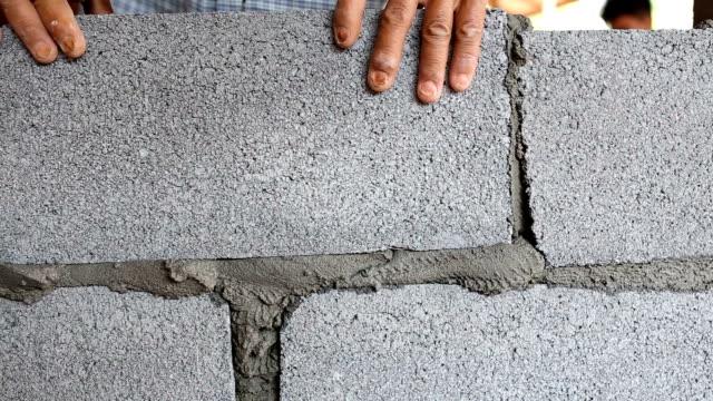 construction worker. mason bricklayer installing brick