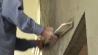 construction worker plaster cement wall, 4k