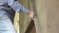 Construction worker plaster cement wall
