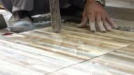 construction worker tiling floor, dolly shot 4k