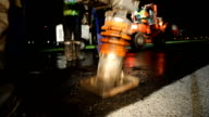 MS Construction worker using compactor on freshly resurfaced road, Cape Town, South Africa