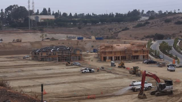 Construction workers building foundations for homes in San Diego California Carpenters Bulldozers Metalworkers San Diego Home Construction on August...