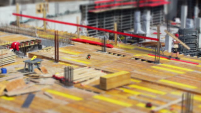 Construction Workers On Site (Tilt Shift And Time Lapse)