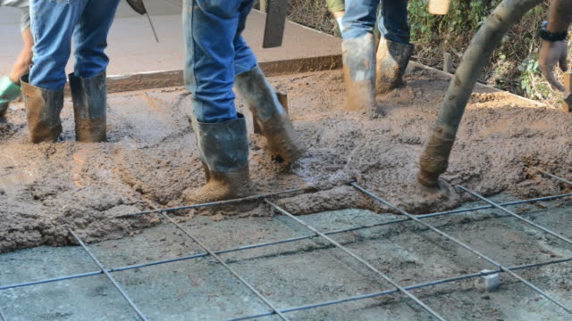 Construction Workers Pouring a Cement Driveway