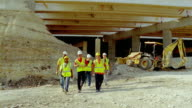 MS, SLO MO, construction workers walking away from construction site, San Antonio, Texas, USA