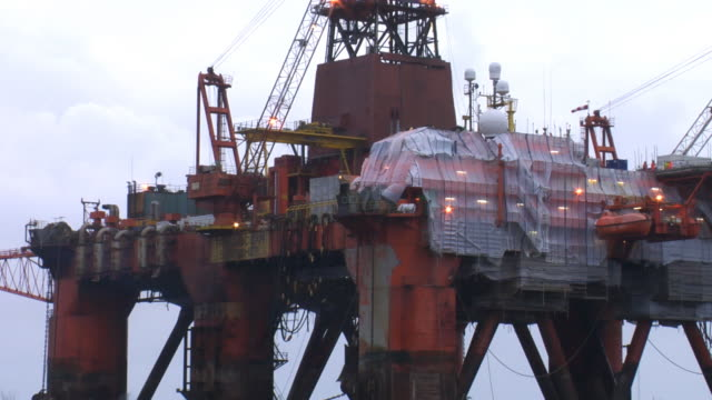 Constuction workers repairing an oil rig