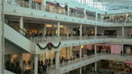 Consumers shop during the Holiday Season at Pentagon City Mall on December 26 2013 in Arlington VA