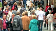 Consumers walking on shopping street