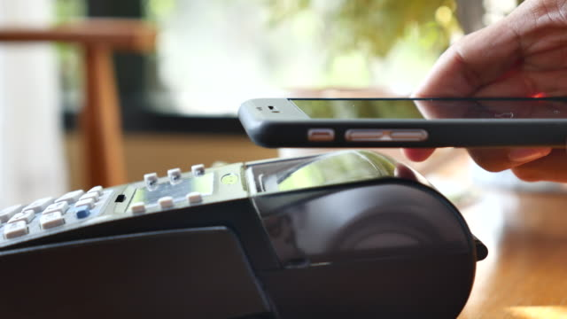 Contactless payment with smart phone in cafe
