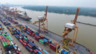 Container Cargo freight ship with working crane bridge in shipyard