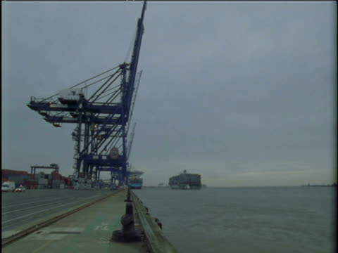 Container ship arrives and is moored at port Felixstowe