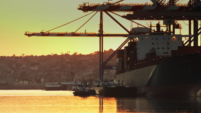 Container Ship Being Unloaded at Sunset