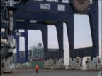 Container ship docks into cargo port Felixstowe