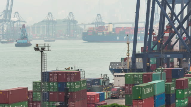Container ship in the harbor in Asia, Zoom out time lapse 4k.