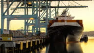Container Ship Preparing to be Unloaded at Port of Los Angeles Dock - Day to Night Timelapse