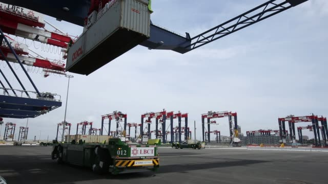 Containers are loaded onto automated guided vehicles by automated stacking cranes during the testing phase of the Long Beach Container Terminal in...