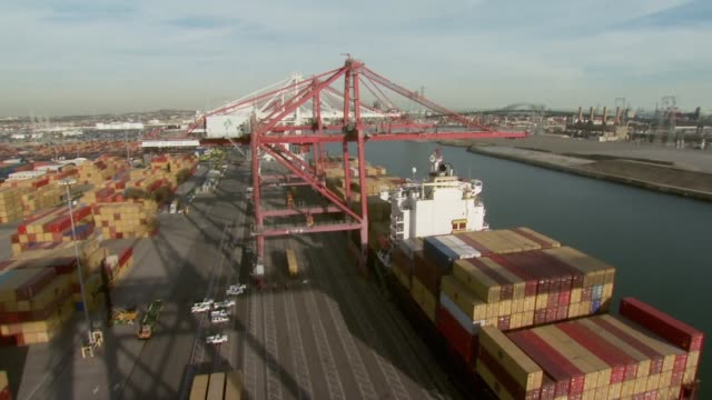 Containers are loaded onto cargo ship in California