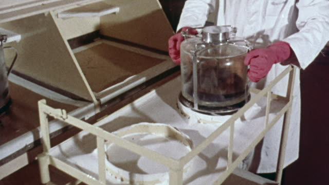 1969 MONTAGE Containers of plutonium in solution being transported and kept at the same height off the ground as a safety precaution / United Kingdom