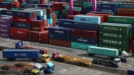 Containers sit stacked among gantry cranes at the Sun Kwang Newport Container Terminal in Incheon New Port in Incheon South Korea on Monday Sept 4...