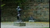 Contemporary Art exhibition in Nottingham EXT Exterior of old building Robin Hood statue People in foyer at 'British Art Show 7' event EXT People...