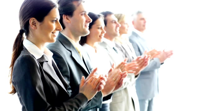 Contemporary business people applauding on a conference.