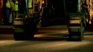 CU continuous track of road resurfacing machine at construction site - night, Cape Town, South Africa