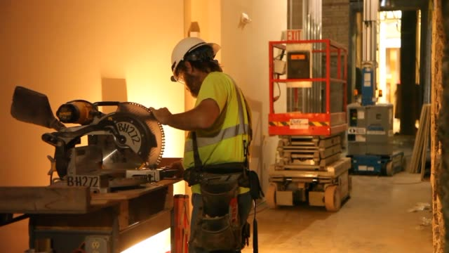 Contractors work on the interiors of the former Schmidt Brewery in St Paul Minnesota converting it to Loft Apartments construction workers installing...
