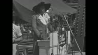 Contralto Marian Anderson singing 'The Star Spangled Banner' at microphones at launch ceremony for SS Booker T Washington VO piano accompaniment