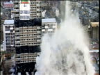 Controlled demolition of two tower blocks in East London