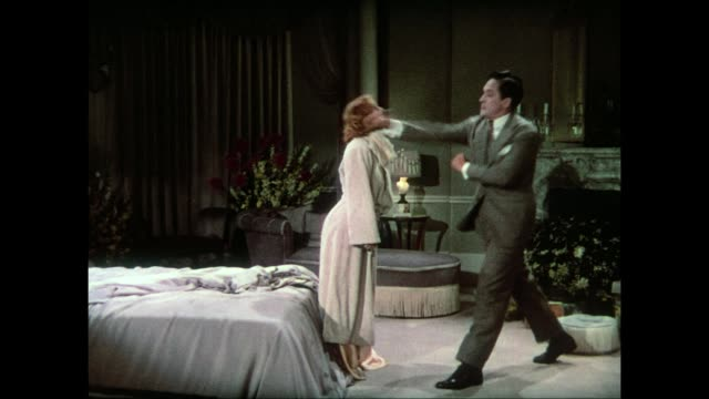 Controlled man (Fredric March) punches and knocks out woman (Carole Lombard) before putting her in bed