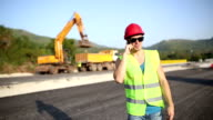 Contstruction worker on the phone