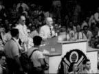 Convention Chairman Samuel Rayburn at platform podium saying 'Harry S Truman having received majority of votes castdeclare him Democratic Nominee' HA...